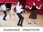 young smiling people practicing ... | Shutterstock . vector #1066374230