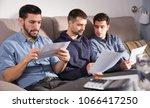 three young men in serious...   Shutterstock . vector #1066417250