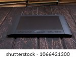 graphic tablet on wood table.... | Shutterstock . vector #1066421300