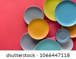 colorful plates composition on... | Shutterstock . vector #1066447118
