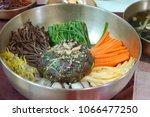 wild vegetable bibimbap  ... | Shutterstock . vector #1066477250