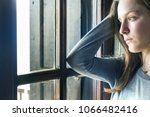 a teenager girl looking away... | Shutterstock . vector #1066482416
