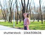 young woman strolling in park ...   Shutterstock . vector #1066508636