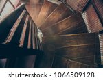 view of rounded wooden stairs... | Shutterstock . vector #1066509128
