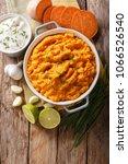 freshly prepared mashed sweet... | Shutterstock . vector #1066526540