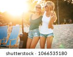 two young female friends... | Shutterstock . vector #1066535180