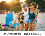 two young female friends... | Shutterstock . vector #1066535183