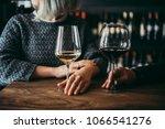 young women enjoying their wine ... | Shutterstock . vector #1066541276