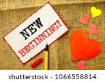 Small photo of Handwriting text New Beginning Motivational Call. Concept meaning Fresh Start Changing Form Growth Life written on Sticky Note Paper by Pointer on the jute background Love Hearts next to it.