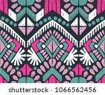 ikat geometric folklore... | Shutterstock .eps vector #1066562456