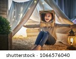 child in an astronaut costume... | Shutterstock . vector #1066576040