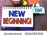 Small photo of Handwriting text writing New Beginning Motivational Call. Concept meaning Fresh Start Changing Form Growth Life written on Notebook Book on the Wooden background Today Hearts Pins next to it.