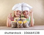 Kids with chef hats and pasta varieties in burlap bags- traditional food - stock photo