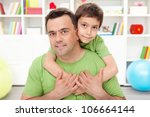 Father and his preschool boy spending time together at home - stock photo