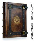 """Small photo of Leather bound book with gilded ancient Viking symbol - view from the left side of the front cover. English translation of the symbol is: """"That Which Shows the Way"""""""