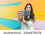 hipster woman taking selfie... | Shutterstock . vector #1066678376