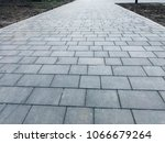 stone pavement in perspective.... | Shutterstock . vector #1066679264