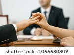 a woman puts a wedding ring in...   Shutterstock . vector #1066680809