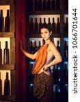 attractive slim brunette posing ...   Shutterstock . vector #1066701644