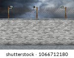 border prison wall with... | Shutterstock . vector #1066712180