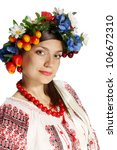 Beautiful Ukrainian embroidered shirt, and a wreath - stock photo