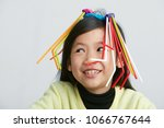 asian children play with straws.... | Shutterstock . vector #1066767644