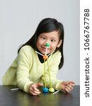 asian children play with straws.... | Shutterstock . vector #1066767788