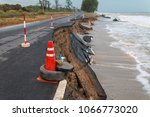 waves of sea erode the road. | Shutterstock . vector #1066773020