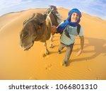 selfie with camel in the sahara ... | Shutterstock . vector #1066801310