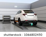 rear view of electric suv car... | Shutterstock . vector #1066802450