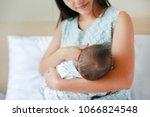 Close Up Infant Baby Feeding...