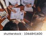 a group of businessmen meet to... | Shutterstock . vector #1066841600