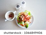 salad and crispy bacon in white ... | Shutterstock . vector #1066849406
