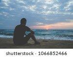 rueful  sorrowful  mournful ... | Shutterstock . vector #1066852466