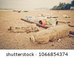 garbage in the sea affecting... | Shutterstock . vector #1066854374