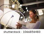 pretty  young woman choosing... | Shutterstock . vector #1066856483