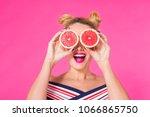 beauty model girl takes juicy... | Shutterstock . vector #1066865750