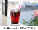 berry fruit ice tea on a table  ... | Shutterstock . vector #1066870406