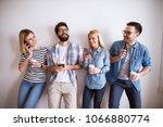 group of young joyful people... | Shutterstock . vector #1066880774