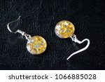 resin earrings with yellow... | Shutterstock . vector #1066885028