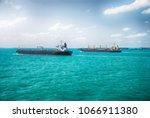 cargo ships sailing in ocean | Shutterstock . vector #1066911380