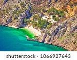 idyllic beach and stone village ...   Shutterstock . vector #1066927643
