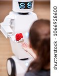 white cute service robot is... | Shutterstock . vector #1066928600