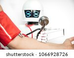 medical assistance robot is... | Shutterstock . vector #1066928726