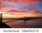 Small photo of View of Golden Gate Bridge from Sausalito. Magic sunrise against the backdrop of the famous Golden Gate Bridge. An inexpressible beauty of colors makes a photo voluminous.