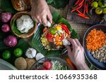 hands holding sticky rice to... | Shutterstock . vector #1066935368
