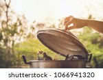 fish steamed in steaming pot | Shutterstock . vector #1066941320