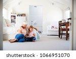 grandmother and granddaughter... | Shutterstock . vector #1066951070