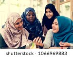 group of students using mobile... | Shutterstock . vector #1066969883