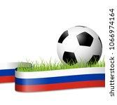 soccer ball lying in the grass... | Shutterstock .eps vector #1066974164